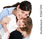 Close up portrait of friendly mother and her daughter. Isolated on white background. - stock photo