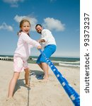 Happy summer holiday - family playing on the beach - stock photo