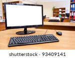 Modern personal computer on desktop in office room - stock photo
