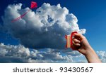 Flying a red kite in blue sky with clouds - stock photo