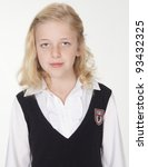 Portrait medium head shot of preteen blond girl in school uniform with blond hair isolated against white background - stock photo