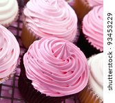 Cupcakes with bright pink frosting.  Delicious eating. - stock photo