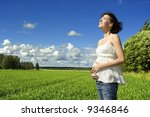 a pregnant woman smiling on a...   Shutterstock . vector #9346846