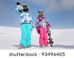 Two girls on the snow - stock photo
