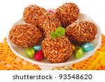 sweet dessert with toffee and puffed rice cookies in the shape of eggs for child - stock photo