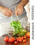 man preparing salad | Shutterstock . vector #93555451
