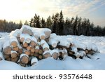 A Stack Of Wooden Logs At...