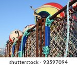 Close up of large commercial crab pots and colorful floats with blue sky in the background - stock photo