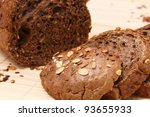 Black bread on table with slice - stock photo