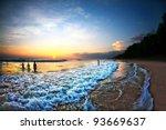 People Swimming In Ocean Durin...