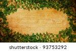 green Fresh leaves frame on old paper vintage - stock photo