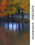 Stock photo colorful autumn foliage reflection in lake 93815656
