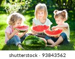 Group Of Happy Children Eating...