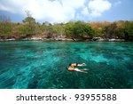 traveler snorkeling over coral... | Shutterstock . vector #93955588