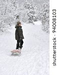 Smiling Boy Walking With Sleds...