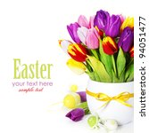 spring tulips with easter eggs  on white background (with sample text) - stock photo