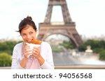 Paris woman eating pancake in front of Eiffel Tower, Paris, France during europe travel - stock photo