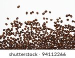 Scattered Coffee Beans On Whit...