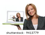 Young girl holding laptop computer and smiling isolated on white - stock photo