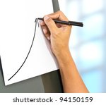 Business hand drawing a rising arrow, representing business growth. - stock photo