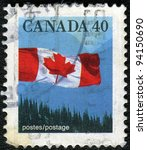 CANADA - 1990: A stamp printed in Canada shows image of the Canadian flag, series, 1990 - stock photo