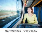 Young woman traveling by train - stock photo