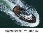 A Tough Little Tugboat Seen...