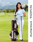Woman playing golf with a bag at the course - stock photo
