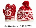 winter cap and mittens knitted with jackard and heart motifs. on white - stock photo