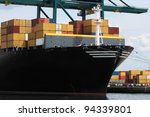 Closeup of a huge container ship in the port of Antwerp - stock photo