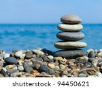 Stack Of Stones On Beach  Sea...