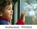 little boy watching the rain... | Shutterstock . vector #9451816
