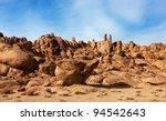 Red Rocks In The Barren Sands...