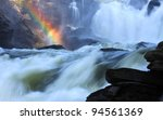 Scenic Waterfall With Rainbow...