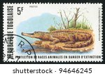 Small photo of TOGO - CIRCA 1977: stamp printed by Togo, shows African Slender-snouted Crocodile, circa 1977