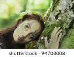 Forest girl embracing beech-tree - stock photo