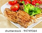 BBQ meat with vegetables and greens closeup - stock photo