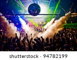 Stock photo hands in air rave with smoke machine and laser crowd nightclub 94782199