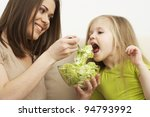 little girl eats vegetarian... | Shutterstock . vector #94793992
