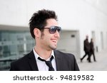 Portrait of a handsome young business man smiling - stock photo