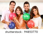 Group of people having fun bowling and smiling - stock photo