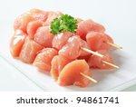 Raw Chicken Skewers On Cutting...