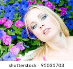 pretty blonde garden posing | Shutterstock . vector #95031703