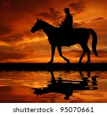 Silhouette Cowboy With Horse In ...
