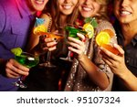 Young people having fun at a birthday party with cocktails - stock photo