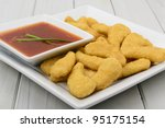 Crispy Chicken & Sweet and Sour Dip - Oriental crispy chicken with a sweet and sour dip. - stock photo