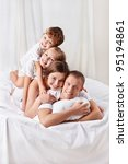 happy family in the bedroom | Shutterstock . vector #95194861
