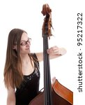 young woman playing the double bass - stock photo