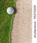 Golf Ball On Green Grass Near...
