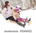 Mother And Daughter Sledging ...